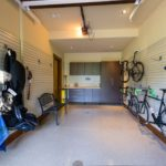 Vail-Mountain-Elegant-custom-garage-floor-with-cabinets-and-slat-wall-organizers