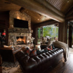 Arrowhead-custom-log-sun-room-with-weiland-bifold-doors